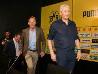 Hans-Joachim Watzke (l.) will keine Trainerdiskussion. ©AFP