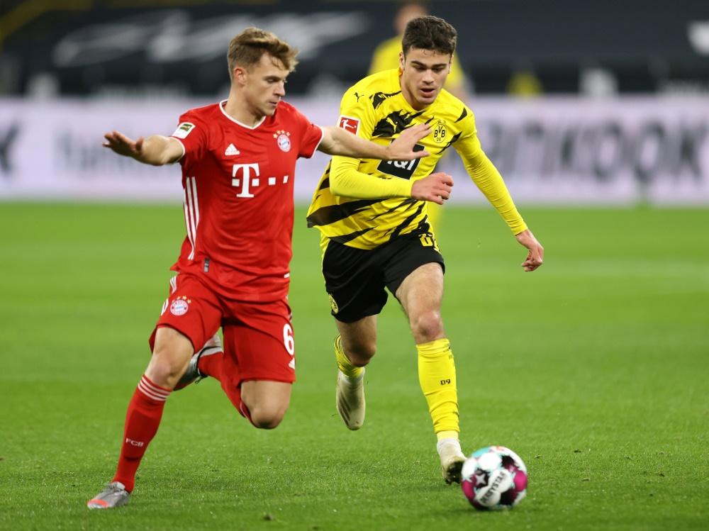 Joshua Kimmich (l.) hat sich gegen Dortmund verletzt. ©FIRO/SID
